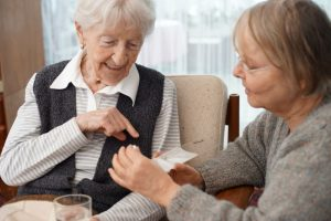 90-year-old-lady-at-home-with-her-carer-choosing-medication-this-file-has-a-professional-witnessed_t20_6y1jP6
